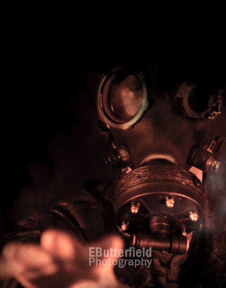 Person in a gas mask reaching toward viewer